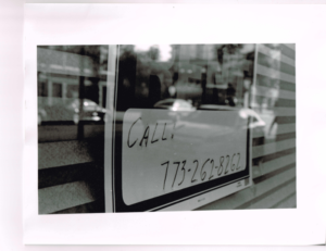 """A photo of a sign reading """"Call 773-262-8262"""" shot on 35mm film."""